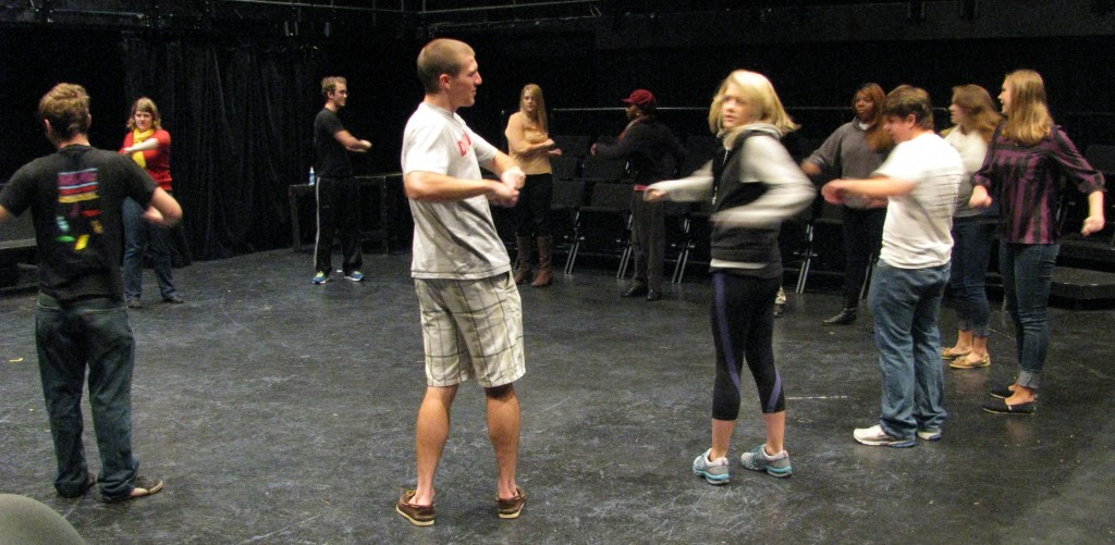 Students learn vocal and physical warm-ups to during Acting Classes at Denison.