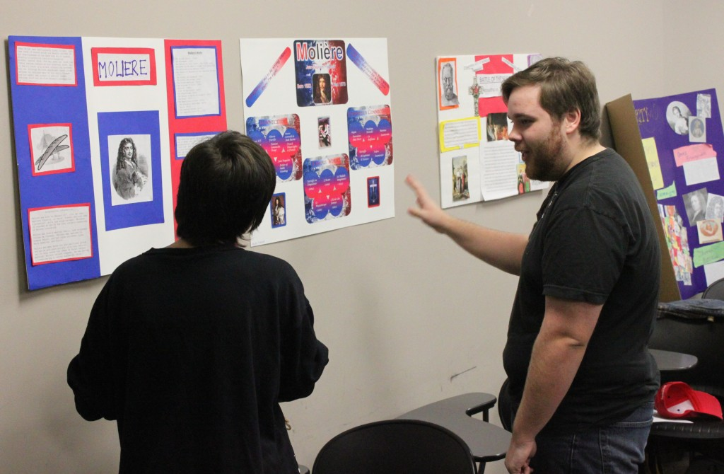 Otterbein students prepare to show classmates the posters they have made summarizing their research papers.